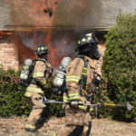 January 28, 2018 - Shortly after arrival and an initial interior attack, fire breaks through a window, and crews go to work from the outside. Bedford, Texas